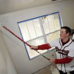 Atlanta Braves player Craig Kimbrel rolls paint on a wall in a bedroom as Braves catcher Clint Sammons gets more paint. The Atlanta Braves Country Caravan is heading to Birmingham, Alabama on Saturday, February 6. Braves players Clint Sammons, Craig Kimbrel, Steven Marek, and Braves broadcaster and Hall of Famer Don Sutton will help paint the walls of  a Habitat for Humanity House that will be owned by LaToya Maiden. . (The Birmingham News / Joe Songer)